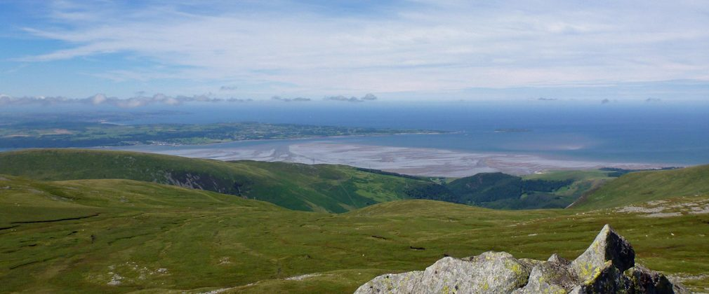 Looking north from Bera Bach in the Carneddau range with views over the Menai Straits and Anglesey.