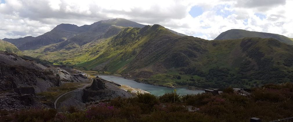 Looking across from Dinorwic Quarry across Llyn Peris over to Clogwyn Mawr and Tryfan with Snowdon and Crib Goch behind them. Photo: Judith Thomas.